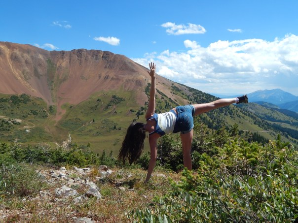 Victoria Lise does yoga pose in backcountry