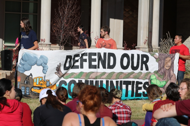 Victoria Lise Standing Rock Support Defend Our Communities Sign at DU Campus