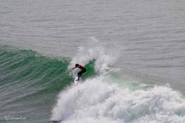 Victoria Lise Captures Surfer Riding Wave