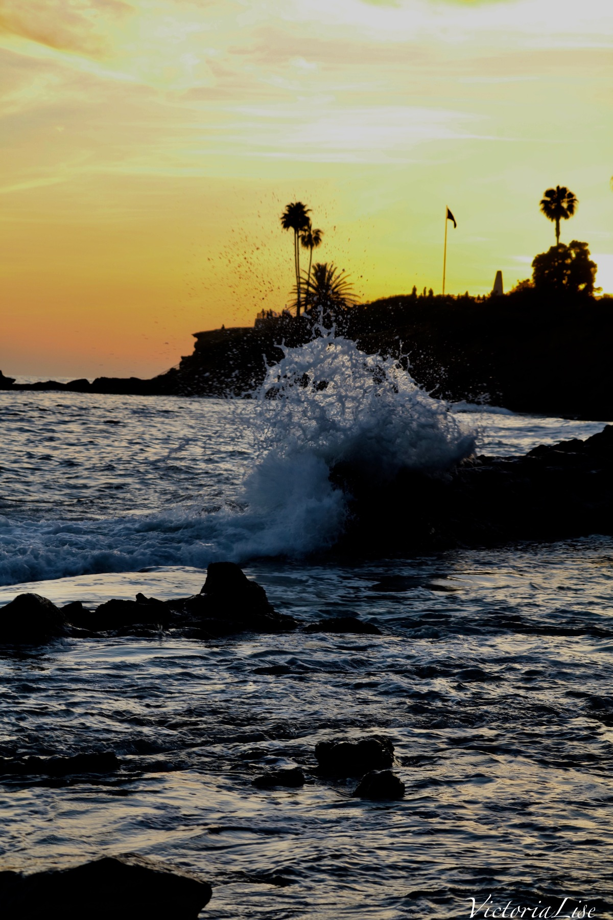 Victoria Lise Laguna Beach Sunset Wave Splashing Against Rocks