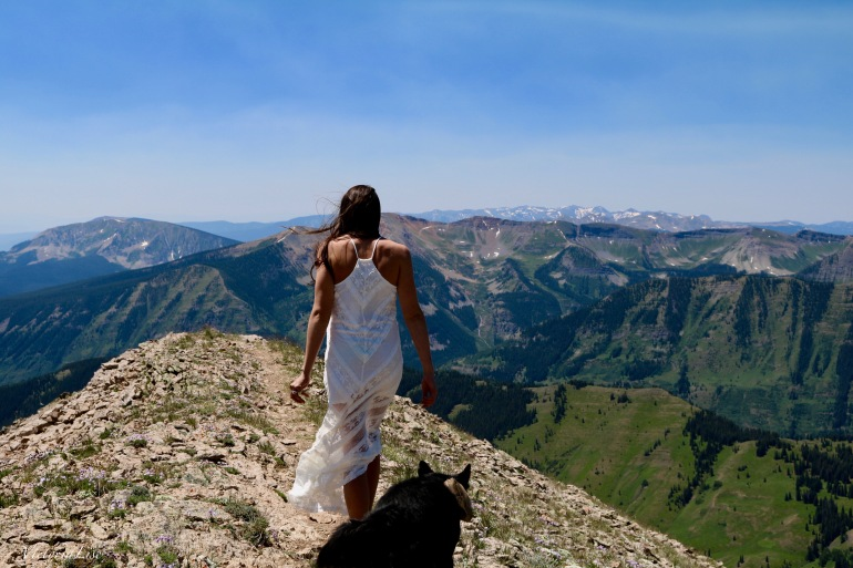 Victoria Lise walks mountain trail as untraditional wedding aisle in MinkPink dress