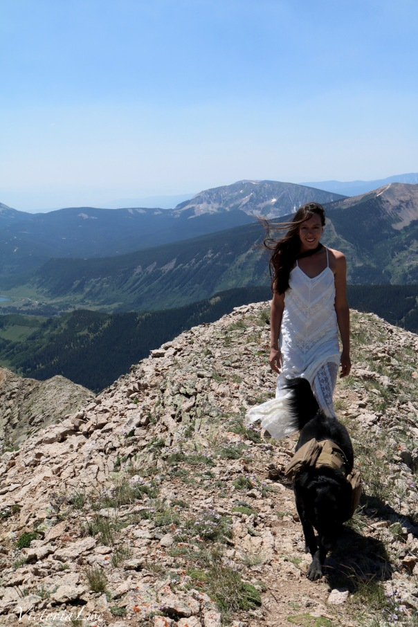 Victoria Lise in lace MinkPink dress atop gothic mountain Colorado