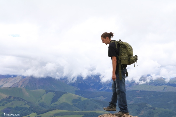 Alex Theaker stands on edge of the world atop Mt. CB