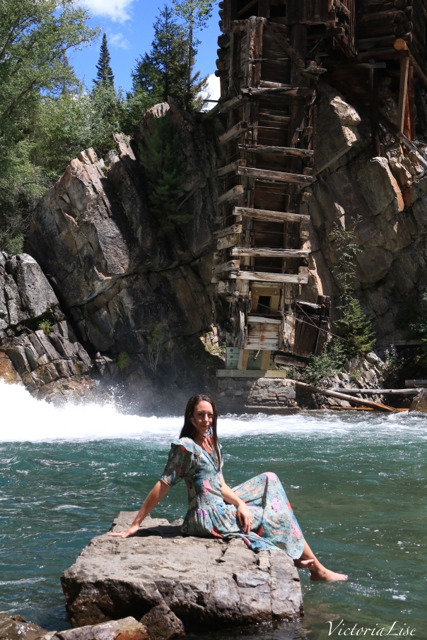 Victoria Lise sits in Crystal River with iconic Crystal Mill