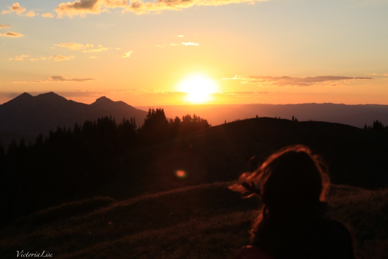 Victoria Lise watches sunset from Mt. Axtell