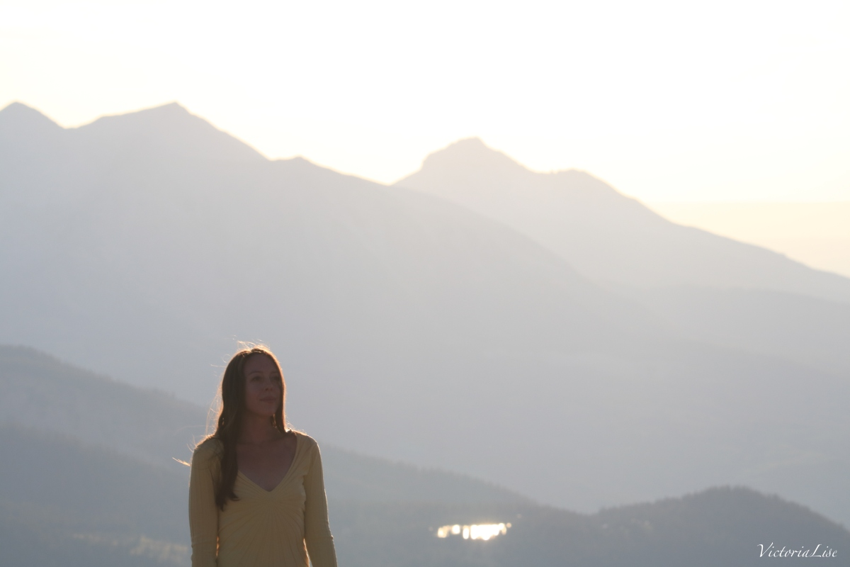 Victoria Lise atop Rocky Mountain at Sunset