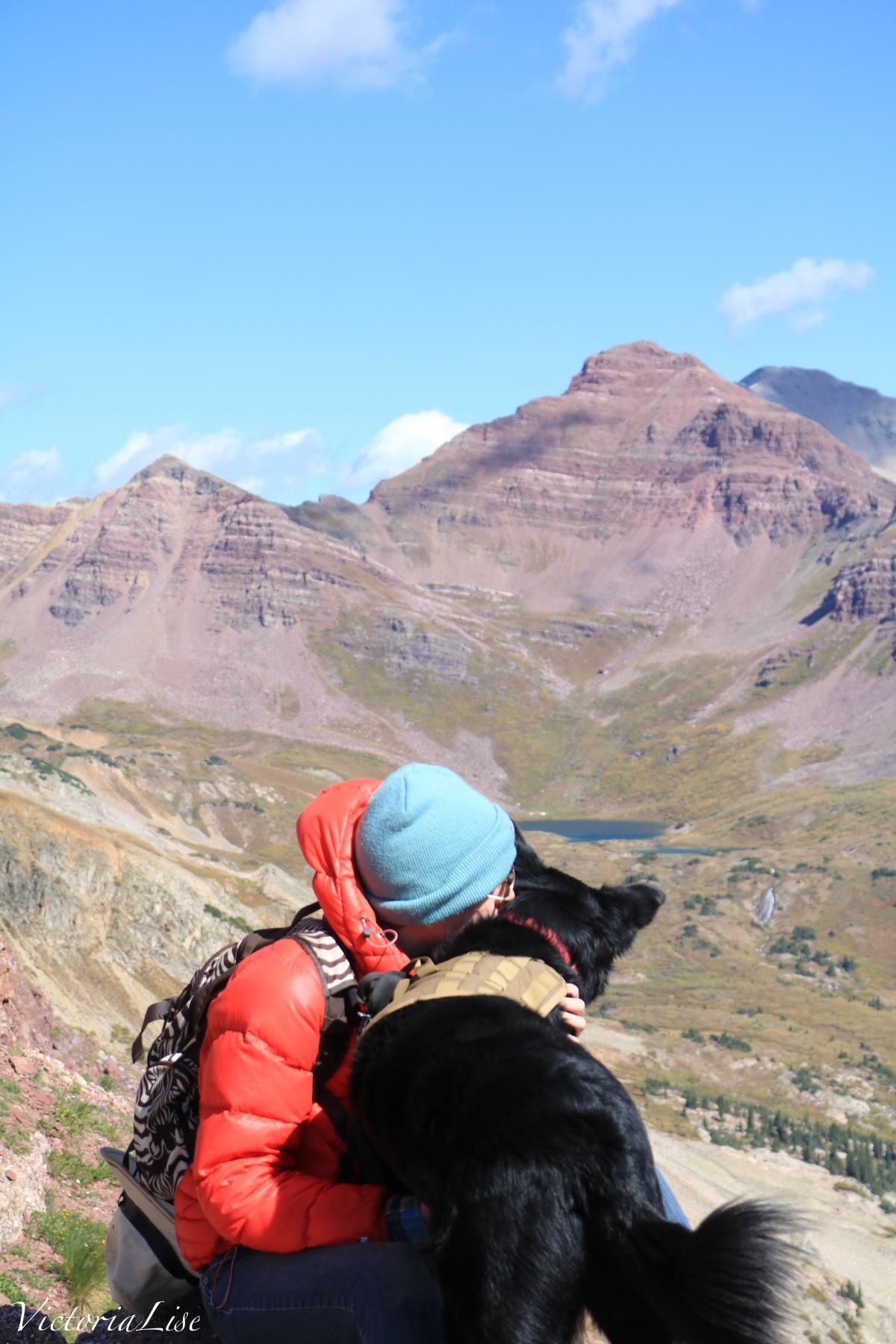 Victoria Lise and dog, Styx near summit of Teocalli mountain Colorado