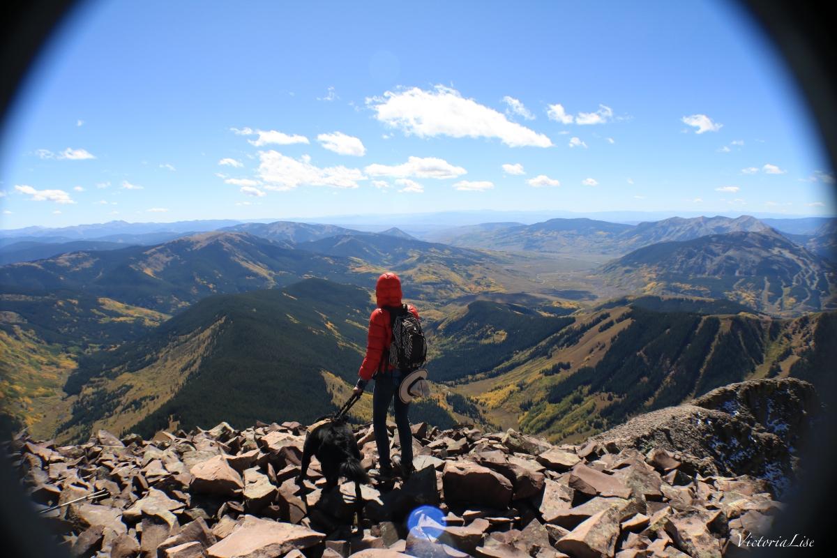 Victoria Lise and dog, Styx atop Teocalli Mountain Colorado