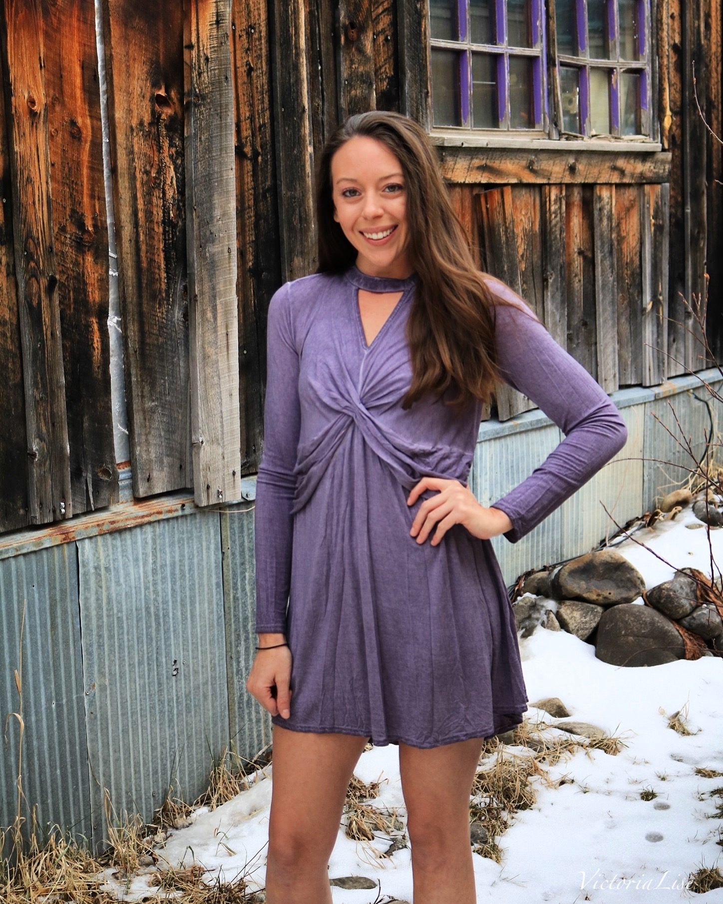 Victoria Lise models purple dress in collaboration with local business.