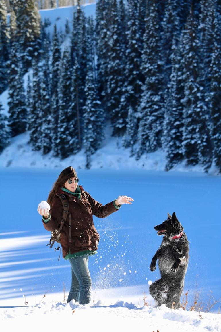 Victoria Lise throws snowball to dog, Styx. 2018