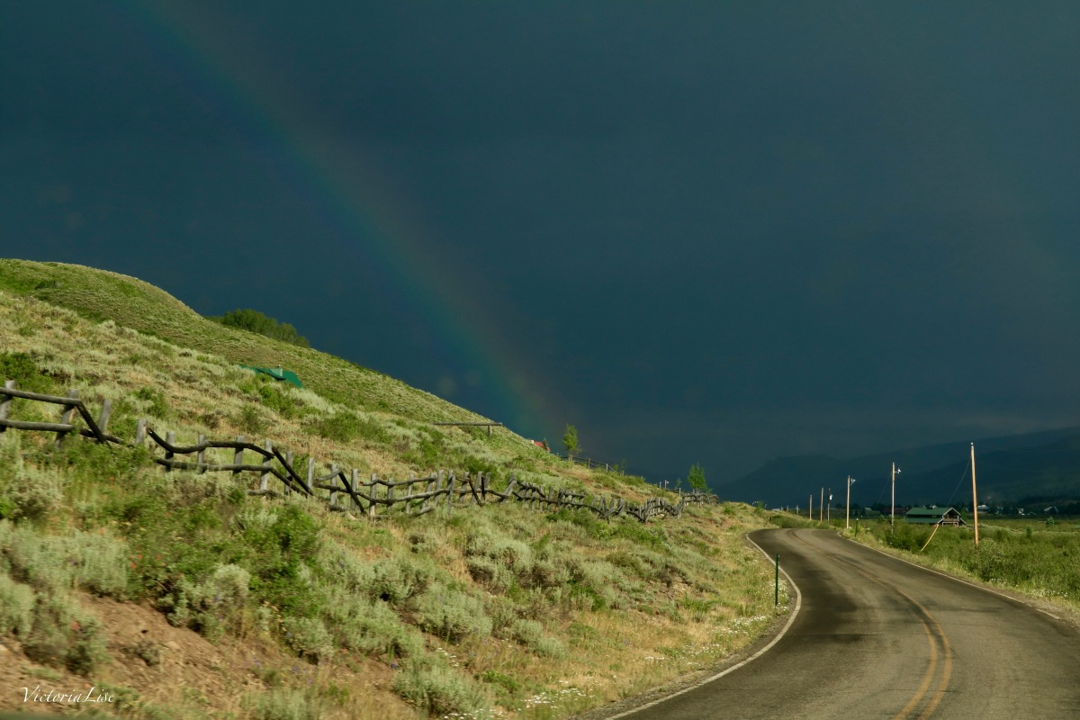 A Modern Colorado Mountain Road Under a Timeless Rainbow. ©Victoria Lise