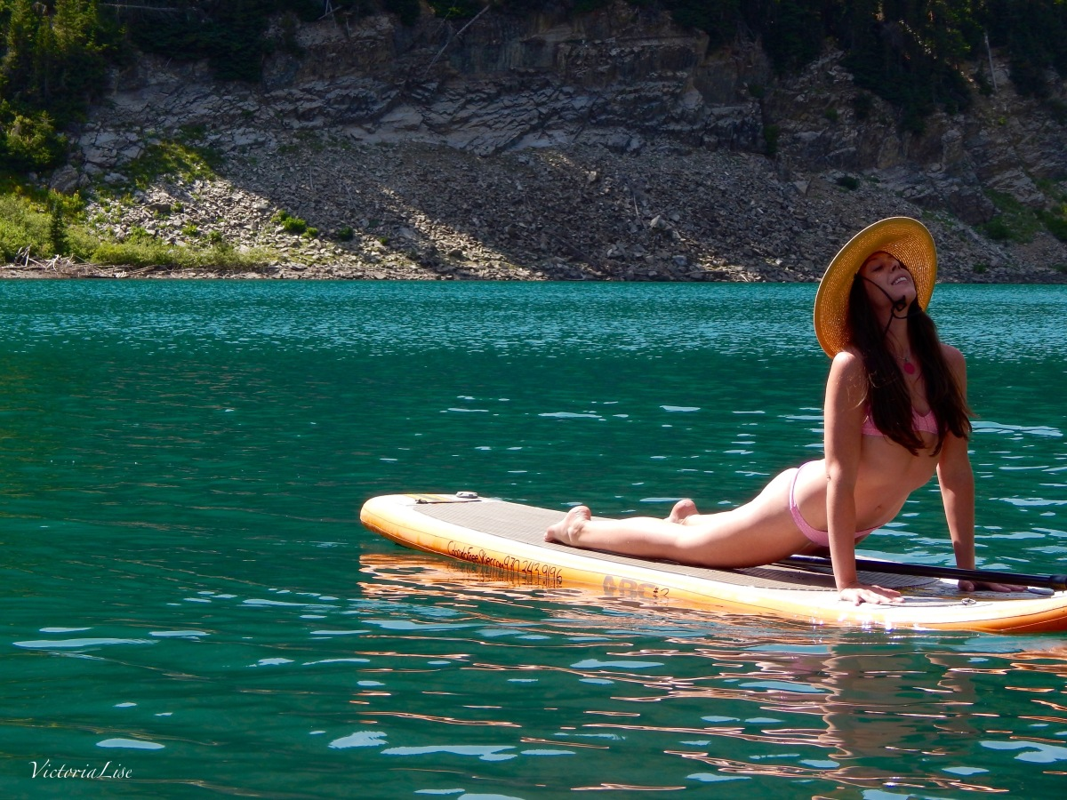 Victoria Lise doing SUP yoga on Emerald Lake, Colorado