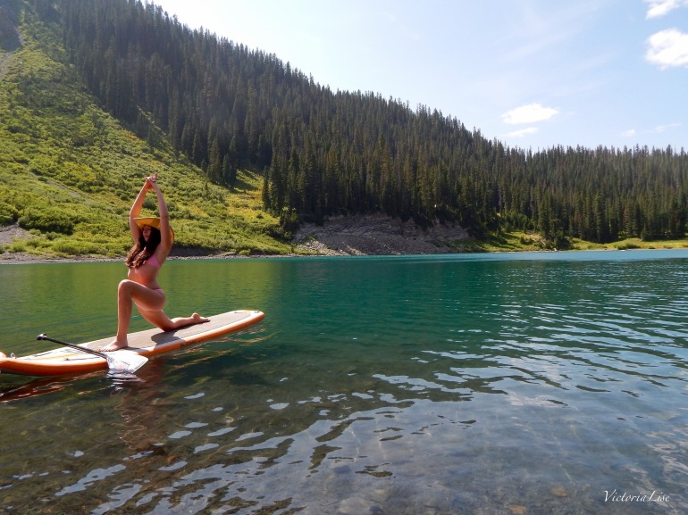 Victoria Lise practicing SUP yoga on Emerald Lake, Colorado.