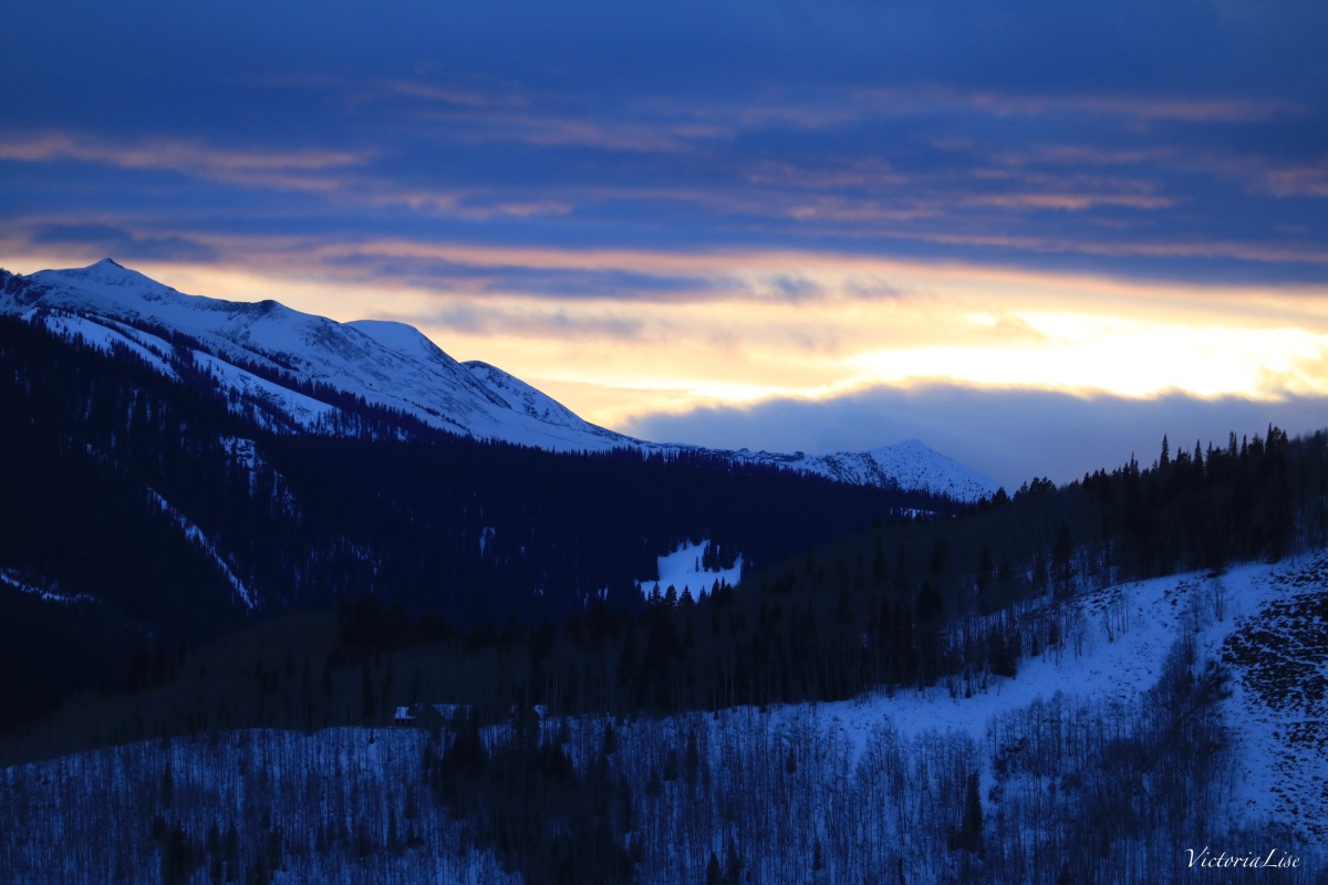 Colorado sunset aglow in between clouds. ©Victoria Lise