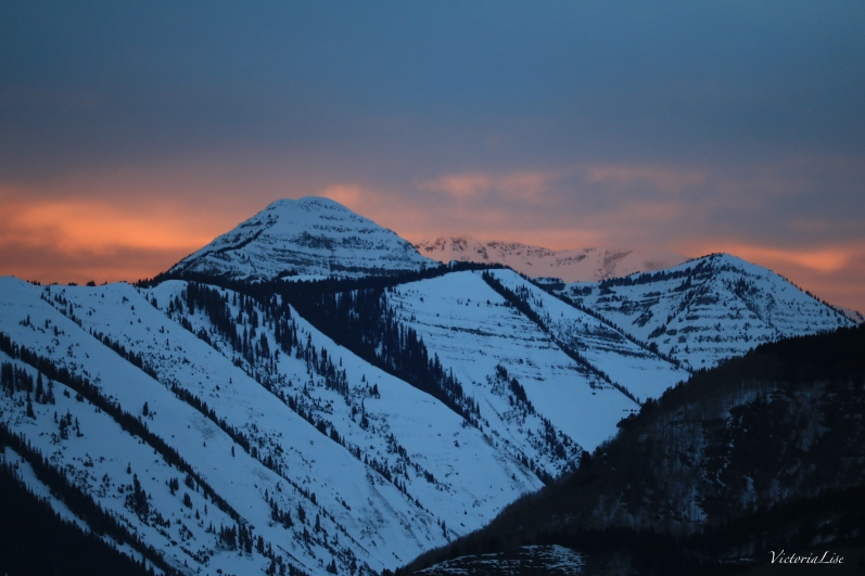 Sun setting over Colorado's snow-capped mountains. ©Victoria Lise
