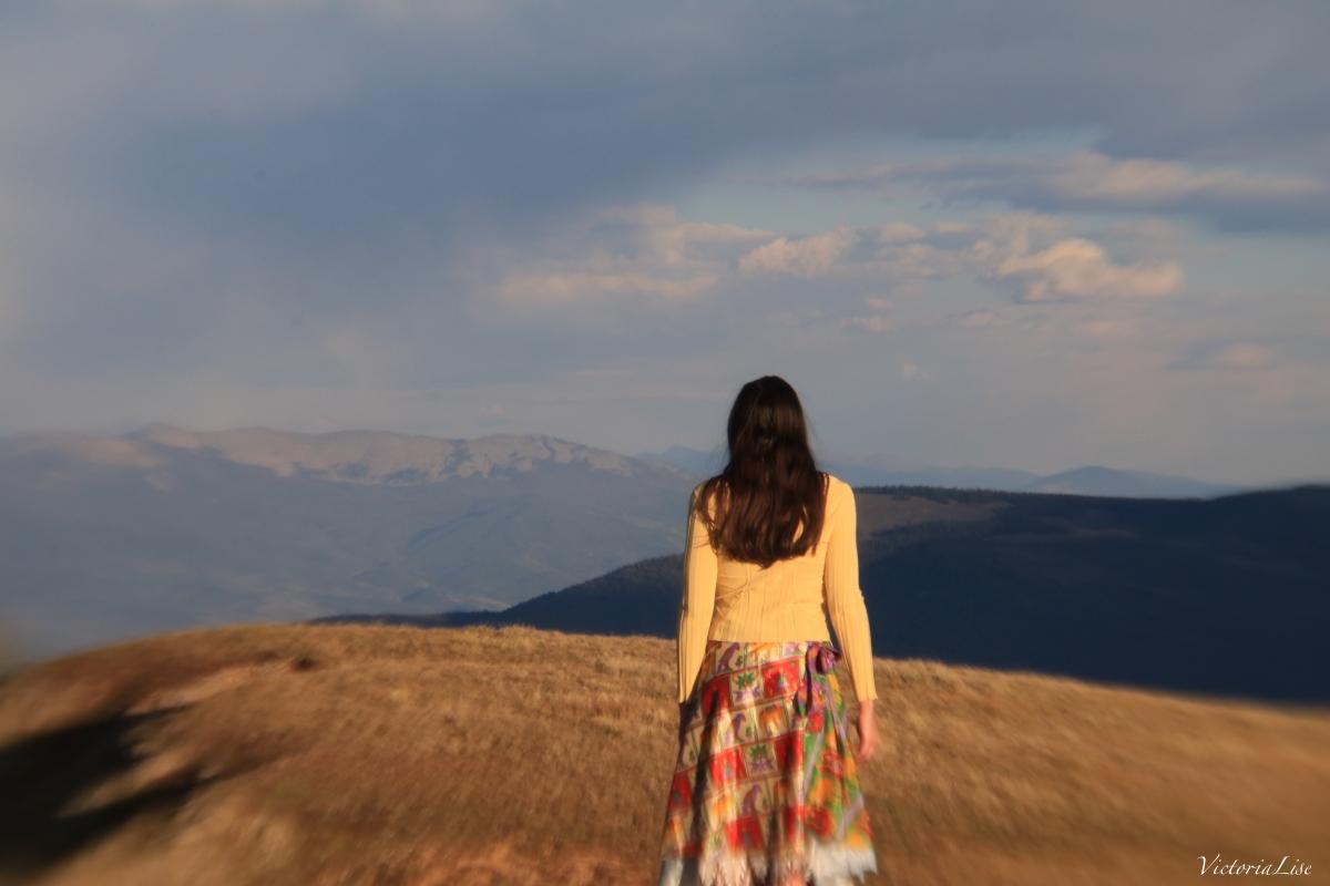 Victoria Lise walks the summit of Mt. Axtell, Colorado.