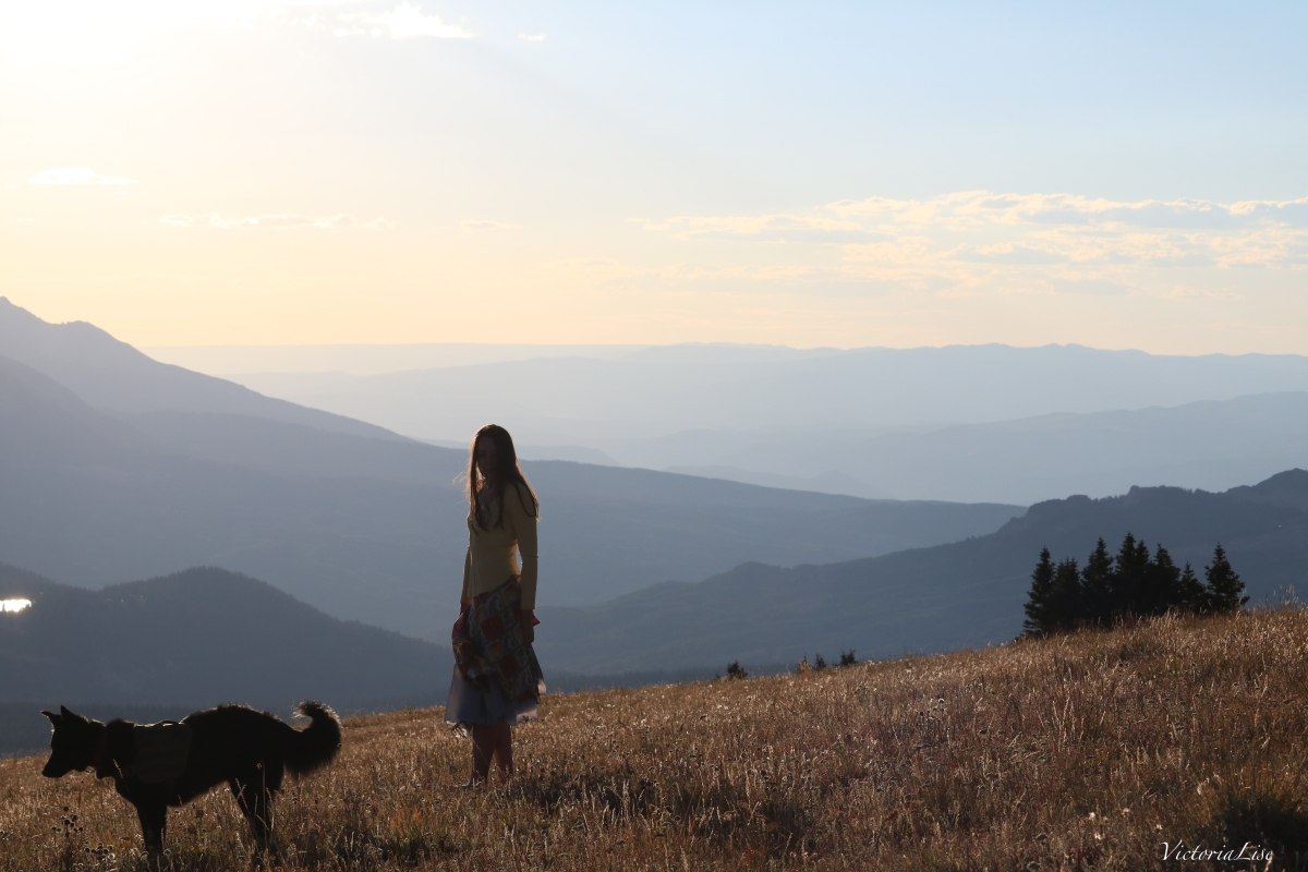 Victoria Lise and rescue dog, Styx atop Mt. Axtell at sunset. Colorado.