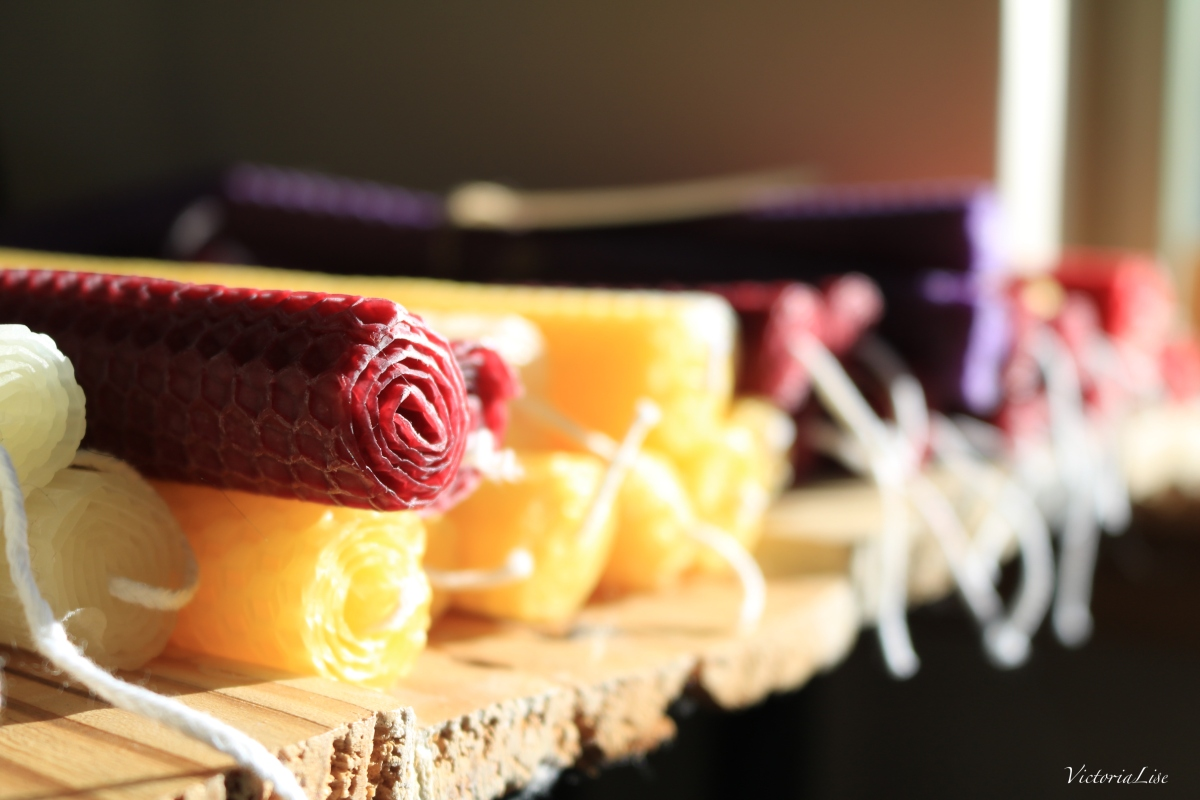Colorful assortment of hand-crafted beeswax candles.