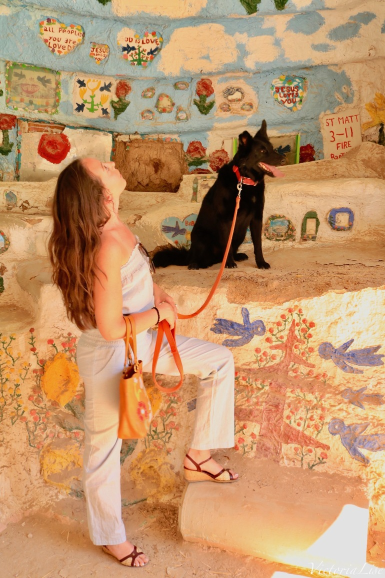 Victoria Lise and dog, Styx in Salvation Mountain Museum.