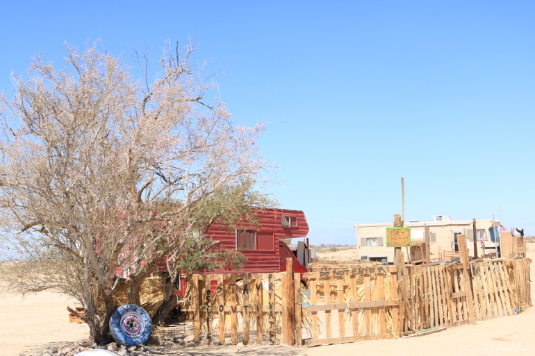 Camp Freedom adorned with a pallet fence. Slab City, CA. © Victoria Lise 2018.