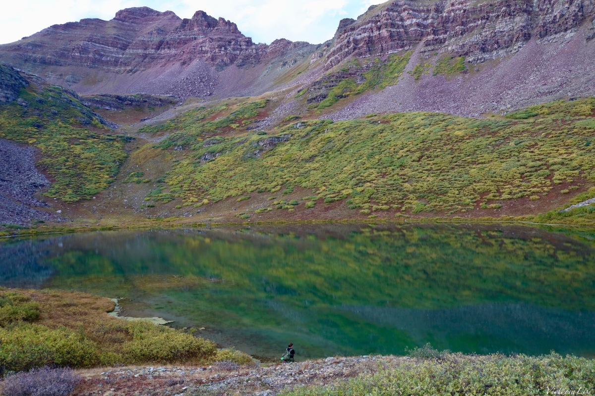 Alex, looking into the green waters of Twin Lakes, CO. ©Victoria Lise